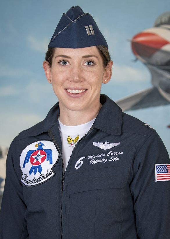 Official photo of pilot in uniform.
