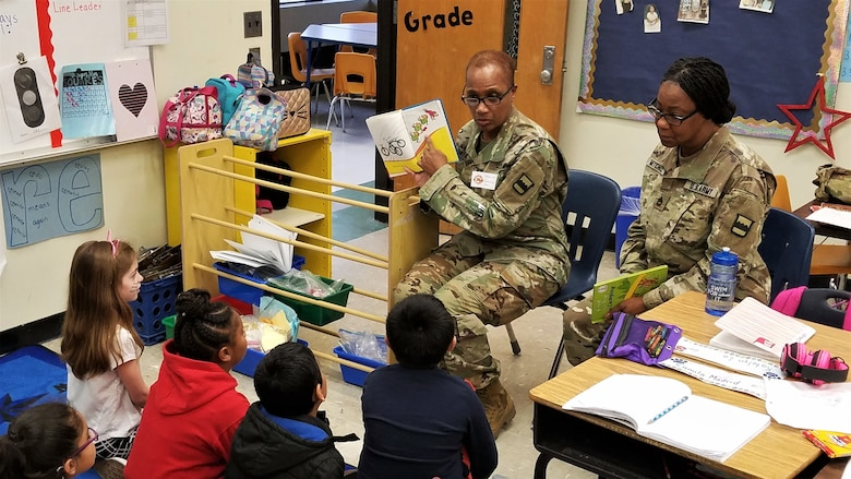"""80th Training Command (TASS) U.S. Army Reserve Soldiers and Civilians enjoyed reading to Hopkins Road Elementary School children, celebrating National Read Across America Day, in honor of Dr. Seuss' birthday. Hopkins Elementary Reading Specialist Mrs. Christy Smith said that inviting the Soldiers to the school means a lot, not only to the kids, but to the parents and teachers as well. """"Our kids look up to the Soldiers and see them as role models, and we absolutely love that,"""" said Smith."""