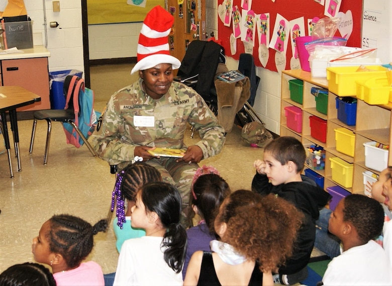 "80th Training Command (TASS) U.S. Army Reserve Soldiers and Civilians enjoyed reading to Hopkins Road Elementary School children, celebrating National Read Across America Day, in honor of Dr. Seuss' birthday. Hopkins Elementary Reading Specialist Mrs. Christy Smith said that inviting the Soldiers to the school means a lot, not only to the kids, but to the parents and teachers as well. ""Our kids look up to the Soldiers and see them as role models, and we absolutely love that,"" said Smith."