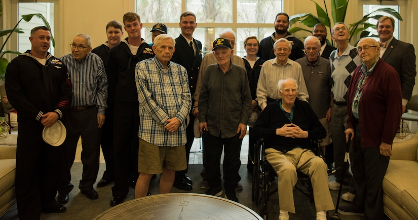 USS Charleston's ship company stands with Vietnam, World War II and military veterans March 11, 2019, at the Somerby of Mount Pleasant, S.C., a senior living community.