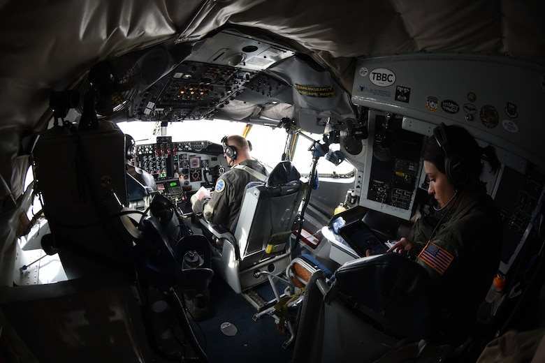 Airmen perform preflight checks on a KC-135