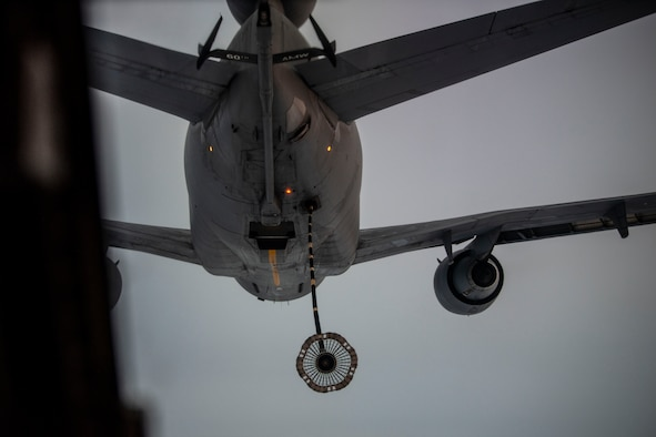 A KC-10 Extender, assigned to the 6th Air Refueling Squadron at Travis Air Force Base, Calif., reaches its aerial refueling hose and drogue basket toward a CV-22 Osprey aircraft, assigned to the 20th Special Operations Squadron, during a Tactical Air-Refueling mission March 11, 2019, over the Southwest region of the U.S. Aerial refueling allows the receiving aircraft to prolong its time airborne and has also been considered to reduced fuel consumption on long-distance flights. (U.S. Air Force photo by Staff Sgt. Luke Kitterman)