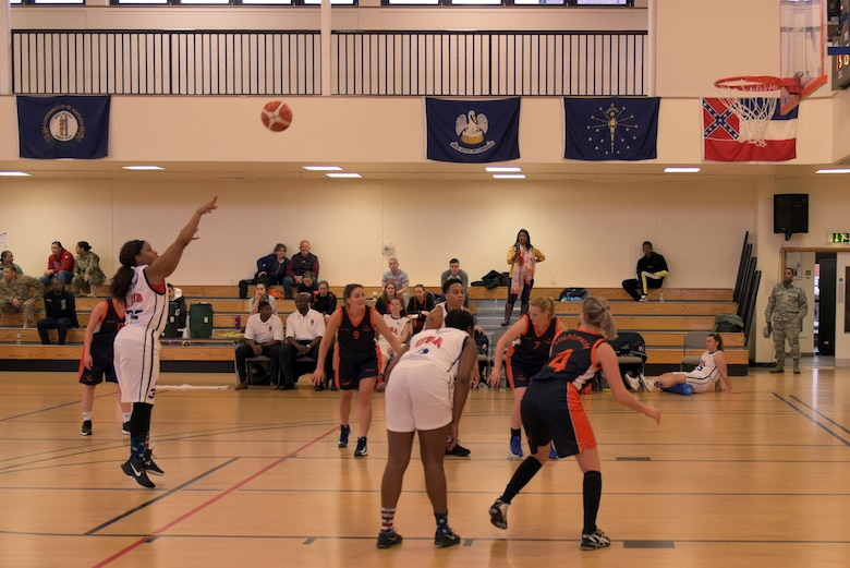 U.S. Air Force Staff Sgt. Simone Dotson shoots a free throw against the Royal Netherlands Air Force team at RAF Mildenhall, England, March 12, 2019. The aim of the Allied Air Command Sports Board mission is to encourage and assist the promotion of international sporting activities. (U.S. Air Force photo by Senior Airman Benjamin Cooper)