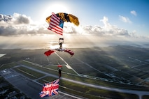 two Soldiers parachuting with American and united kingdom flags flying.