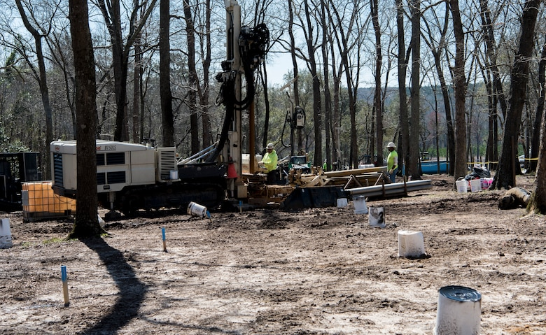 South Atlantic Environmental Drilling and Construction Company workers use a Geoprobe Rotary Sonic drill rig to drill a small diameter pipe into the ground at Sans Souci Farm in Sumter, S.C., March 7, 2019.
