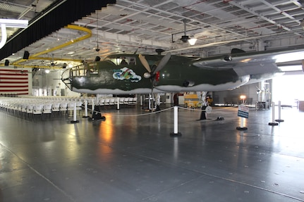 "The B-25 ""Furtle Turtle,"" located on the hanger deck of the USS Yorktown at the Patriots Point Martime Museum in Mount Pleasant, S.C., sits supported by custom-built jack stands just before Airmen from the 437 Maintenance Group from Joint Base Charleston, S.C., reinstalled new wheels and tires."