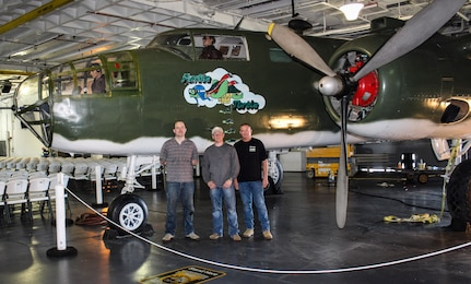 Left to right, Tech. Sgt. Richard Atchison, Master Sgt. Ron Williams and Tech. Sgt. Charles Long, all of the 437th Maintenance Group from Joint Base Charleston, S.C., pose in front of a B-25 bomber at Patriots Point Maritime Museum in Mount Pleasant, S.C.