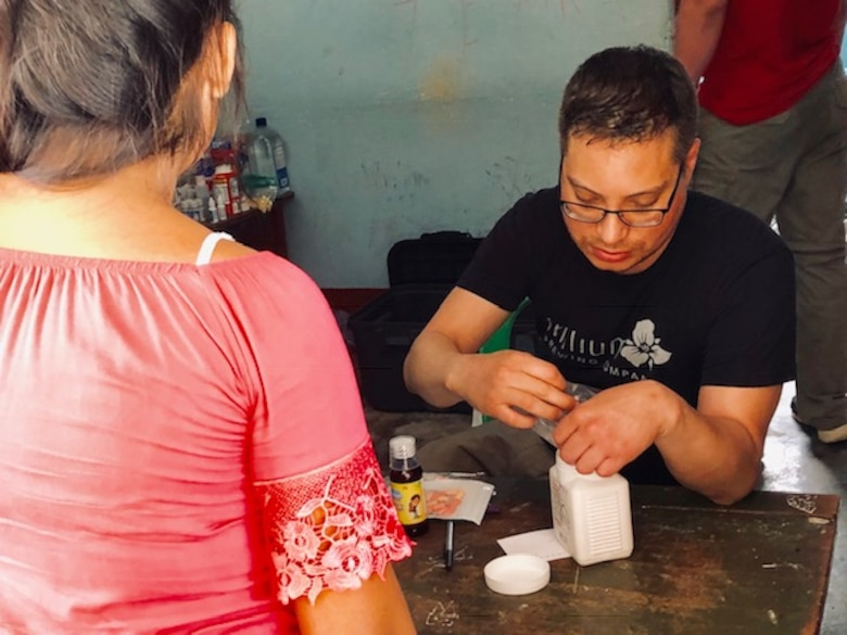 Maj. Pedro Colón, 22nd Medical Support Squadron flight commander of diagnostics and therapeutics, explains a prescription to a patient March 2019, in the San Martin Region, Peru. Colón processed 1,486 prescriptions during the medical mission trip to seven different towns in Peru. (Courtesy photo)