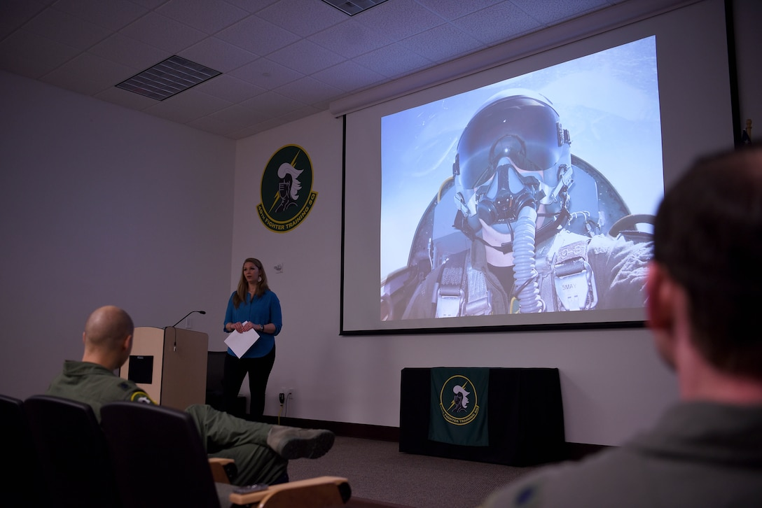 Ashley Schafer speaks to 49th Fighter Training Squadron pilots, March 11, 2019, on Columbus Air Force Base, Mississippi. After the death of her husband, Maj. Richard Schafer, a 49th FTS instructor pilot, in August 2014, she has traveled and spoke to military members and families educating them on how to prepare for the worst. (U.S. Air Force photo by Airman 1st Class Keith Holcomb)