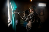A U.S. Marine with Golf Company, 2nd Battalion, 3rd Marine Regiment, III Marine Expeditionary Force, provides security from a window during a military operations in urban terrain (MOUT) exercise on Marine Corps Training Area Bellows, Mar. 14, 2019. Golf improved their unit lethality by utilizing the MOUT facilities to interact with role players, engage in simulated fire fights and set up a defensive position. This exercise was the second stage of the battalion's training event, Exercise Bougainville I, an annual training exercise that strengthens pre-deployment readiness. (U.S. Marine Corps photo by Sgt. Jesus Sepulveda Torres)