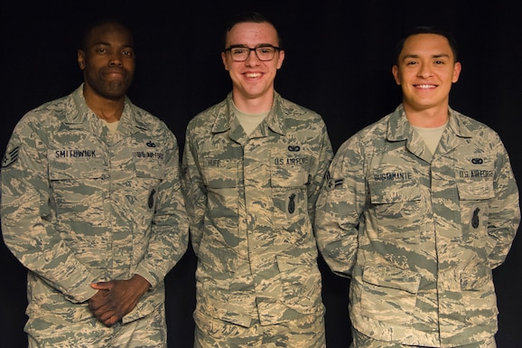 PETERSON AIR FORCE BASE, Colo. – (From left to right) Staff Sgt. Branden Smithwick, 21st Security Forces Squadron military working dog handler, Airman 1st Class Matthew Huff, 21st SFS installation entry controller, and Airman 1st Class Anthony Bustamante, 21st SFS armorer, pose for a photo, Feb. 12, 2019 at Peterson Air Force Base, Colorado. Smithwick, Huff and Bustamante reacted quickly and efficiently to an off-base vehicle rollover, ultimately saving the life of the driver. They will be presented with the American Red Cross Hometown Heroes Military Hero Award for their actions above and beyond the call of duty. (U.S. Air Force photo by Staff Sgt. Emily Kenney)