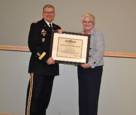 Army Brig. Gen. Mark Simerly, DLA Troop Support commander, left, presents Jennifer Hamby, right, Audit Readiness division, a plaque for her exemplary model of public service and government leadership during the Women's History Month Program March 13. Hamby was selected Woman of the Year in the non-supervisory GS-11 and above category. (Photo by Alexandria Brimage-Gray)