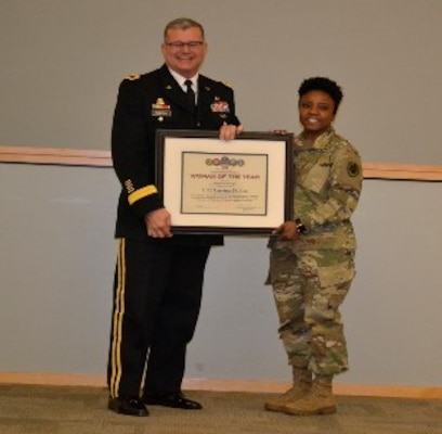 Army Brig. Gen. Mark Simerly, DLA Troop Support commander, left, presents Army Lt. Col. Latrina Lee, J3/5 supervisor, a plaque for her exemplary model of public service and government leadership during the Women's History Month Program March 13. Lee was selected Woman of the Year in the supervisor/manager of the year category. (Photo by Alexandria Brimage-Gray)
