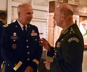 New York National Guard Adjutant General, Maj. Gen. Raymond Shields, talks with Brazilian Army General Gerson Menandro Garcia De Freitas, before a state partnership signing, on the USS Intrepid, Manhattan, N.Y., March 14, 2019. The State Partnership between the NYNG and Brazil is a Department of Defense joint security cooperation program executed by the State Adjutants General in support of Combatant Commanders and U.S. Chiefs of Mission to help achieve security cooperation objectives and Department of Defense policy goals.
