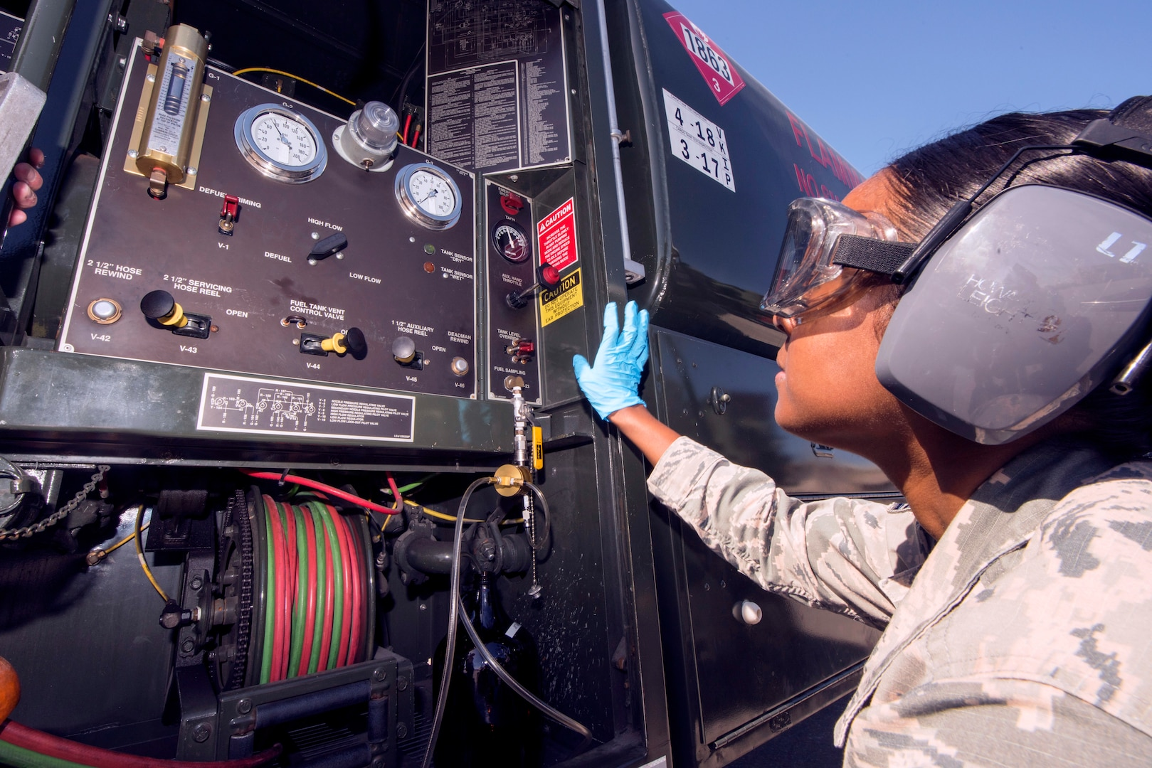 U.S. Air Force Staff Sgt. Akila Mohabir, the 6th Logistics Readiness Squadron fuels laboratory technician, withdraws fuel from a R-11 fuel truck at MacDill Air Force Base, Florida, March 14, 2019.