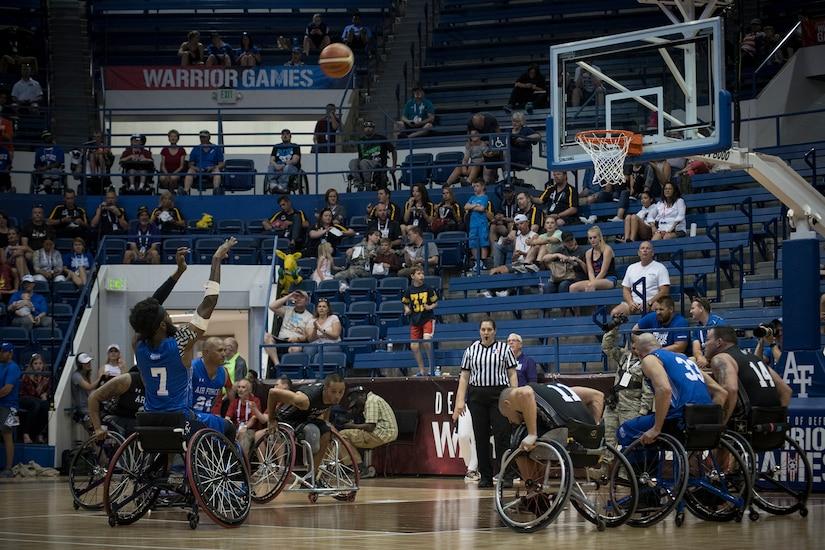 Athletes play wheelchair basketball.