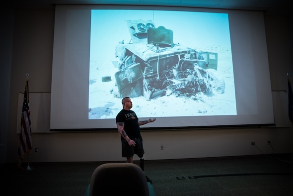 Marine Corps Staff Sgt. (Ret.) Daniel Gilyeat, who lost his left leg in an explosion in July 2005 when his Up Armored Humvee ran over a double-stacked anti-tank mine on a dusty battlefield in Iraq, speaks to students of the Aerospace Medicine Primary course at the United States Air Force School of Aerospace Medicine March 4. Gilyeat was presenting a photo of what his vehicle looked like after the explosion. (U.S. Air Force photo/Richard Eldridge)