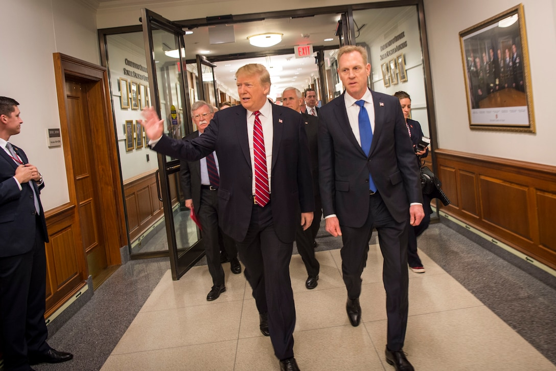 President Donald J. Trump walks down a hallway with Acting Defense Secretary Patrick M. Shanahan.