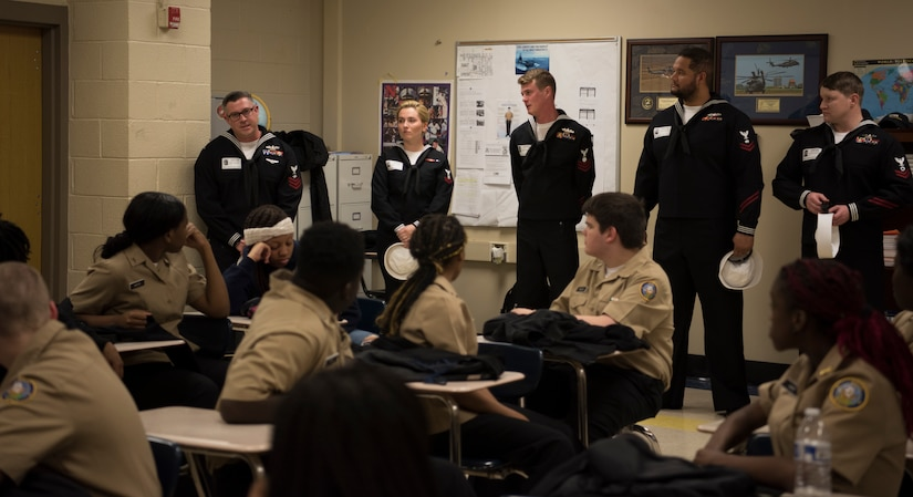 Members of the USS Charleston's ship's company talk to JROTC students at North Charleston High School during a Navy Week school visit March 13, 2019, in North Charleston, S.C.