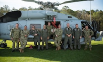 Members of the Helicopter Maritime Strike Squadron Four-Zero stand on the field of St. Johns High School during a Navy Week school visit March 14, 2019, on Johns Island, S.C.