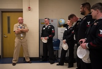 Retired Master Chief Petty Officer Brantley Altman, left, JROTC instructor for North Charleston High School, talks to some of the USS Charleston's ship's company during a Navy Week school visit March 13, 2019, in North Charleston, S.C.