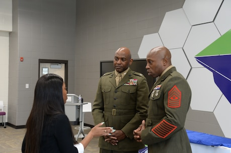 Col. Alphonso Trimble, commanding officer, and Sgt.Maj. Johnny Higdon, base sergeant major, joined other community leaders for the second annual handshake competition at the Commodore Conyers College and Career Academy, March 13.