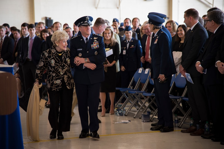 Air Force Chief of Staff Gen. David L. Goldfein escorts Dr. Lucy Greene during the Celebration of Life ceremony honoring Mr. W. Parker Greene, March 14, 2019, at Moody Air Force Base, Ga. Greene, a steadfast Air Force advocate and one of the most influential military civic leaders passed away Dec. 18, 2018. (U.S. Air Force Photo by Andrea Jenkins)