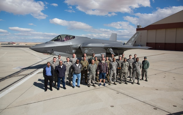 Members of the 461st Flight Test Squadron pose for a photo in front of a newly delivered F-35A March 7, 2019. (Courtesy photo by Chad Bellay/Lockheed Martin)