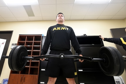 Army Reserve Sgt. 1st Class Tim Sierra, Intelligence Analyst, 85th U.S. Army Reserve Support Command, attempts the 3 Repetition Maximum Deadlift event of the Army Combat Fitness Test at the Battalion Commanders Huddle, Mar. 9, 2019.