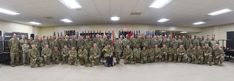 Battalion command team members and staff from the 85th U.S. Army Reserve Support Command and First Army pause for a photo with World War II Veteran, Al Mampre, during the last day of the 85th USARSC's Battalion Commanders Huddle briefing, Mar. 10, 2019.