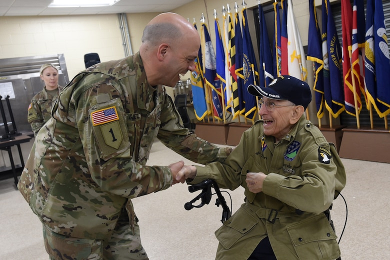 Army Reserve Command Sgt. Maj. Gilbert Garrett, left, command sergeant major of the 2nd Battalion, 337 Regiment, 85th U.S. Army Reserve Support Command, operationally controlled by 157th Infantry Brigade, meets World War II Veteran, Al Mampre, during the last day of the 85th USARSC's Battalion Commanders Huddle briefing, Mar. 10, 2019.