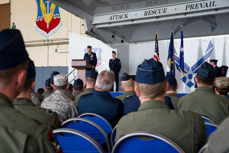 Gen. Mike Holmes, Air Combat Command commander, speaks at the Gallant Unit Citation presentation, March 14, 2019, at Moody Air Force Base, Ga. When deployed, the 74th Fighter Squadron becomes the 74th Expeditionary Fighter Squadron (EFS) which distinguished itself by extraordinary heroism while supporting Operation INHERENT RESOLVE and engaging with an opposing force from July 15, 2017, to Jan. 15, 2018. During the six-month deployment, the 74th EFS executed operations in three different arenas: Operations ECLIPSE, TIDAL WAVE II, and TALON SPEAR. The incredible volume of strikes combined with enemy threats truly tested the entire war-making mechanism. The unmatched ability of 74th EFS pilots prevented a strategically catastrophic aircraft loss and prevented countless civilian and friendly deaths without degradation to their primary mission, ultimately leading to the decisive defeat of Islamic State of Iraq and Syria in Iraq and Syria. (U.S. Air Force photo by Airman 1st Class Taryn Butler)