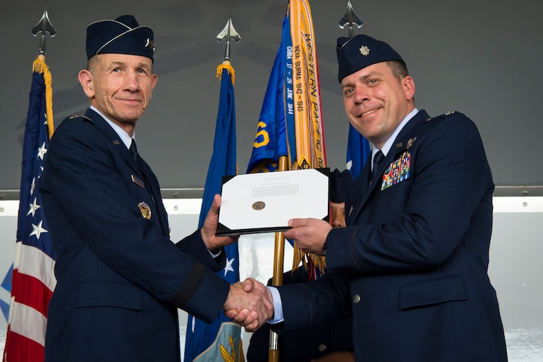 Gen. Mike Holmes, Air Combat Command commander, presents the Gallant Unit Citation to Lt. Col. Craig Morash, 74th Fighter Squadron commander, March 14, 2019, at Moody Air Force Base, Ga. When deployed, the 74th FS becomes the 74th Expeditionary Fighter Squadron (EFS), whose mission is to provide close air support, air interdiction and combat search and rescue to facilitate Operation INHERENT RESOLVE objectives. The 74th EFS distinguished itself by extraordinary heroism while engaged in conflict with an opposing force from July 15, 2017, to Jan. 15, 2018.  During this time, the 74th EFS flew over 1,600 sorties and 10,000 hours in support of the operation, striking nearly 2,500 targets and killing 3,100 Islamic State of Iraq and Syria (ISIS) fighters. Upon the 74th EFS departure, the United States declared ISIS defeated in Syria and Iraq. (U.S. Air Force photo by Airman 1st Class Taryn Butler)