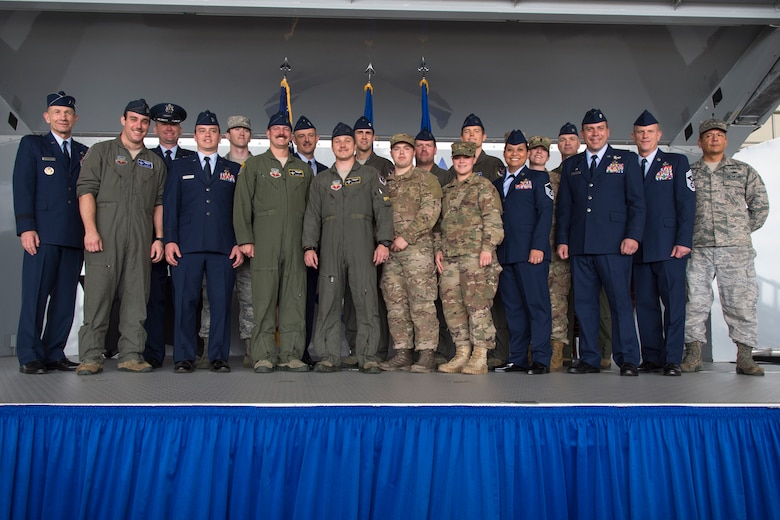 "Gen. Mike Holmes, left, Air Combat Command commander, poses with the 74th Fighter Squadron (FS) during the Gallant Unit Citation presentation, March 14, 2019, at Moody Air Force Base, Ga. When deployed, the 74th FS becomes the 74th Expeditionary Fighter Squadron (EFS) which distinguished itself by extraordinary heroism while supporting Operation INHERENT RESOLVE and engaging with an opposing force from July 15, 2017, to Jan. 15, 2018. The individual combat actions help to demonstrate the exceptional degree of professionalism, dedication to duty, gallantry and heroism that separates the 74th EFS from other fighter units. Five Distinguished Flying Crosses, seven Single Event Air Medals and 83 Air Medals with ""Combat"" Device were awarded to squadron members. The 83 ""Combat"" devices represent that nearly 100 percent of 1,600 sorties were flown under significant risk to self. The unmatched ability of 74th EFS pilots prevented a strategically catastrophic aircraft loss and prevented countless civilian and friendly deaths without degradation to their primary mission, ultimately leading to the decisive defeat of ISIS in Iraq and Syria. (U.S. Air Force photo by Airman 1st Class Taryn Butler)"