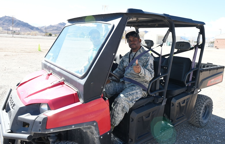 Tech. Sgt. Caprice, 867th Attack Squadron flight chief, prepares to attempt a slalom course while wearing impairment simulating goggles on a closed course during Creech Air Force Base's second annual anti-drug town hall and DUI awareness course March 7, 2019. Representatives from supporting agencies across base converged to educate Creech Airmen about updated U.S. Air Force drug policies, and the dangers of driving while impaired. (U.S. Air Force photo by Tech. Sgt. Dillon White)