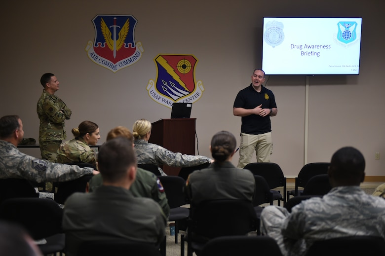 A special agent from the Nellis Air Force Base Office of Special Investigation briefs attendees at the annual anti-drug town hall and DUI awareness course at Creech Air Force Base, Nevada, March 7, 2019. The course, sponsored by the First Sergeant's Council, consisted of briefings from 432nd Wing/432nd Air Expeditionary Wing first sergeants, OSI, and the Alcohol and Drug Abuse Prevention and Treatment office. (U.S. Air Force photo by Tech. Sgt. Dillon White)