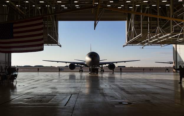 U.S. Airmen with the 22nd Aircraft Maintenance Squadron tow a new KC-46A Pegasus aircraft into Hangar 1126 at McConnell Air Force base, Kansas, Jan. 25, 2019. The KC-46 was displayed at center stage to allow guests a closer look inside the new aircraft. (U.S. Air Force photo by Airman 1st Class Alan Ricker)
