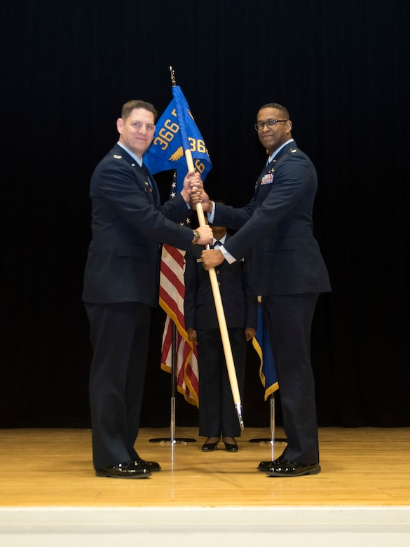 Col. Joe Kunkel, 366th Fighter Wing commander, gives Maj. Brian Williams command of the 366th Financial Acquisition Squadron March 14, 2019 at Mountain Home Air Force Base. Williams is the former 366th Contracting Squadron commander. (U.S. Air Force Photo by Airman 1st Class Hailey Bivens)