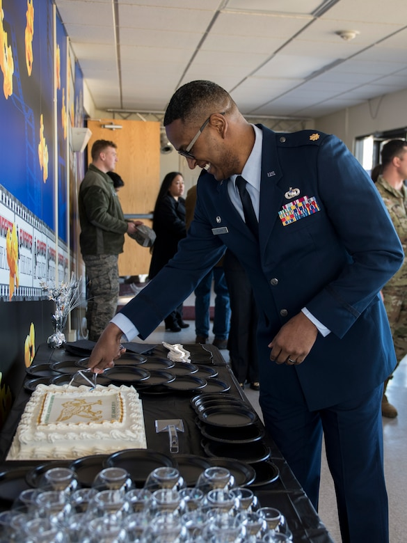 Maj. Brian Williams, 366th Financial Acquisition Squadron commander, cuts the cake after the 366th FAS activation ceremony March 14, 2019 at Mountain Home Air Force Base. Williams is the former 366th Contracting Squadron commander. (U.S. Air Force Photo by Airman 1st Class Hailey Bivens)
