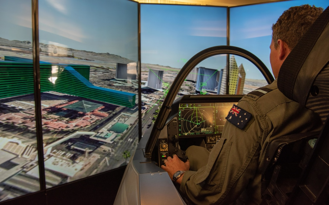 Royal Australian Air Force Air Commodore Darren Goldie, Director General Air Combat Capability, flies in an F-35 simulator during the Pacific F-35 Users Group Conference at Joint Base Pearl Harbor-Hickam, Hawaii, March 12, 2019.