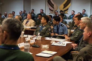 Members of the Pacific F-35 Users Group Conference listen to opening remarks given by the Pacific Air Forces commander at Headquarters PACAF, Joint Base Pearl Harbor-Hickam, Hawaii, March 12, 2019.