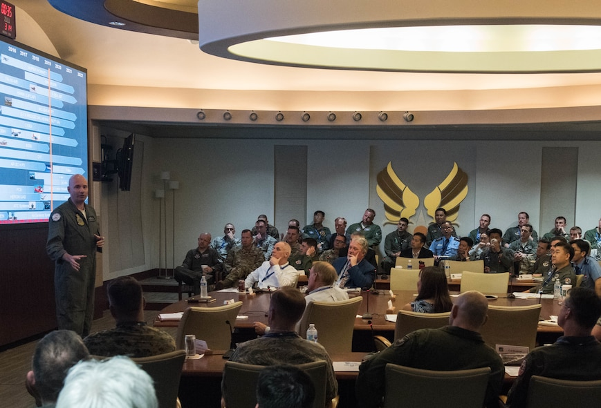 Royal Australian Air Force GPCAPT. John Haly, Director, Air Combat Transition Office, gives a country update briefing during the Pacific F-35 Users Group Conference at Headquarters Pacific Air Forces, Joint Base Pearl Harbor-Hickam, Hawaii, March 13, 2019.