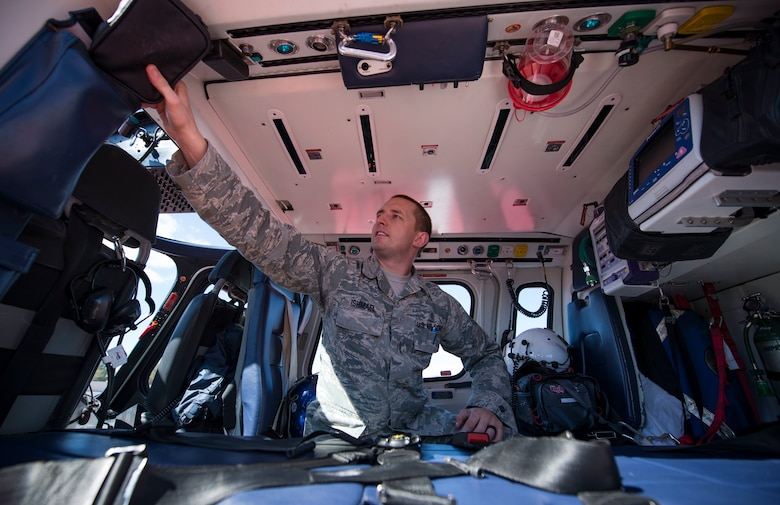 Tech. Sgt. Nicholas Ishamel, 99th Medical Group paramedic, explores the inside of a Mercy Air helicopter on the helipad at the Mike O'Callaghan Military Medical Center, Nellis Air Force Base, Nevada, March 13, 2019. The medical center is in the process of becoming a level 3 trauma center. (U.S. Air Force photo by Airman 1st Class Bailee A. Darbasie)