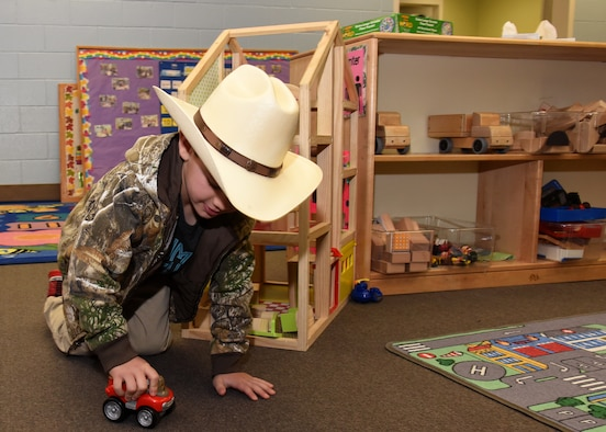 Brantley Cox plays with a toy truck at the Child Development Center on Goodfellow Air Force Base, Texas, March 15, 2019. Cox is one of the 118 children enrolled at the CDC. (U.S. Air Force photo by Airman 1st Class Abbey Rieves/Released)