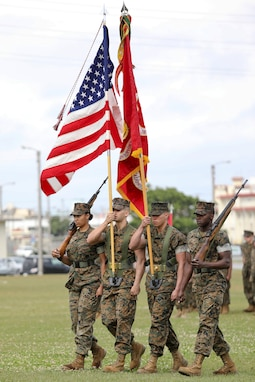 U.S. Marines with 3rd Transportation Support Battalion post the units colors during a relief and appointment ceremony for 3rd Transportation Support Battalion, Combat Logistics Regiment 3, 3rd Marine Logistics Group at Camp Foster, Okinawa, Japan March 15, 2019. Sgt. Maj. Jeffery J. Vandentop ceremoniously transferred accountability and authority of enlisted Marines to Sgt. Maj. Jose A. Beltran during the ceremony. (U.S. Marine Corps photo by Lance Cpl. Armando Elizalde)