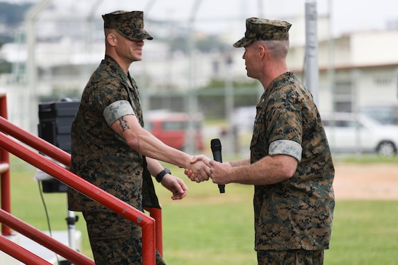 Lt. Col. Matthew Mulvey, right, thanks Sgt. Maj. Jeffery J. Vandentop, left, during a relief and appointment ceremony for 3rd Transportation Support Battalion, Combat Logistics Regiment 3, 3rd Marine Logistics Group at Camp Foster, Okinawa, Japan March 15, 2019. Vandentop ceremoniously transferred accountability and authority of enlisted Marines to Sgt. Maj. Jose A. Beltran during the ceremony. Mulvey, the commanding officer of 3rd TSB, CLR-3, 3rd MLG, is a native of Cherryville, North Carolina. Vandentop is a native of Toronto, Canada. (U.S. Marine Corps photo by Lance Cpl. Armando Elizalde)