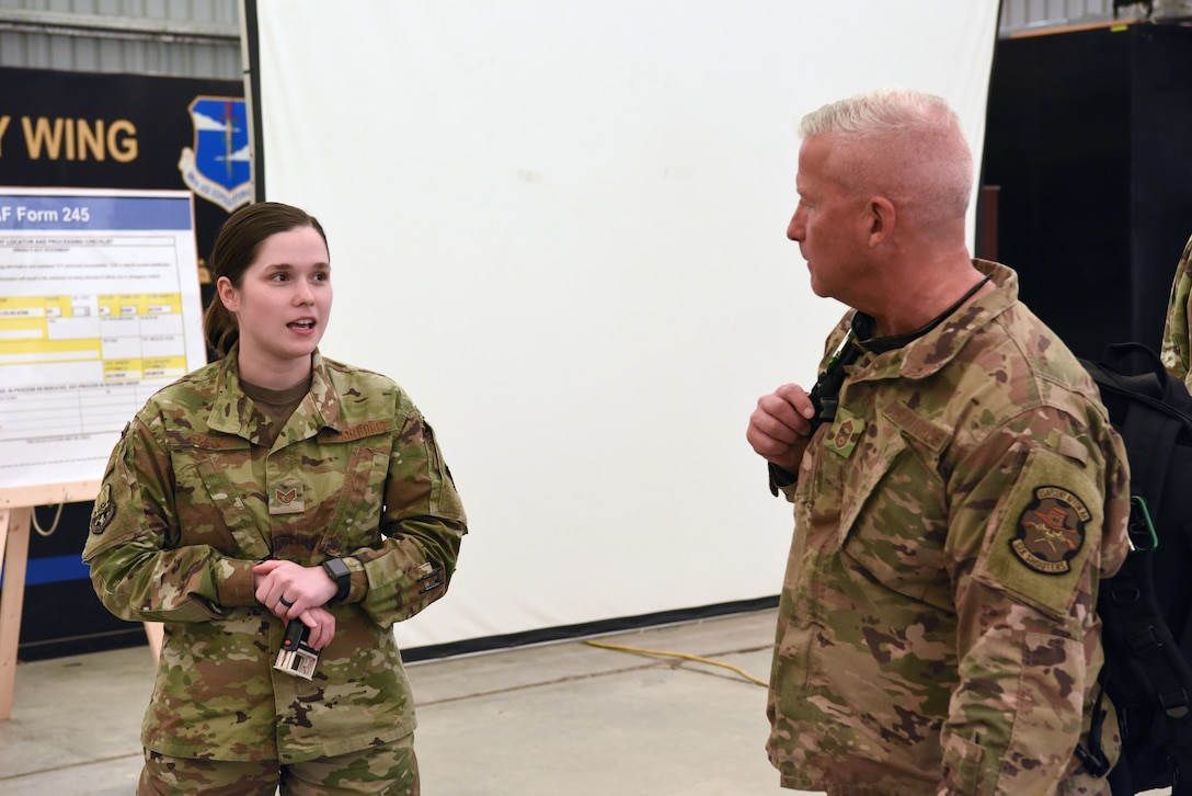 Staff Sgt. Samantha Rak, 380th Air Expeditionary Wing Host Nation Coordination Office immigrations technician, briefs an inbound member at Al Dhafra Air Base, United Arab Emirates, Mar. 5, 2019.