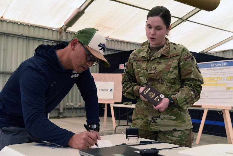 Staff Sgt. Samantha Rak, 380th Air Expeditionary Wing Host Nation Coordination Office immigrations technician, verifies the paperwork of an inbound member at Al Dhafra Air Base, United Arab Emirates, Mar. 5, 2019.