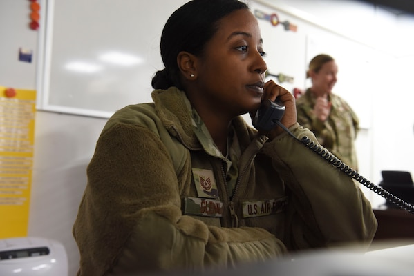 Tech. Sgt. Kathryn Glenn, 380th Expeditionary Logistics Readiness Squadron NCOIC, logistics plans, answers a call about redeployments at Al Dhafra Air Base, United Arab Emirates, Mar. 14, 2019.