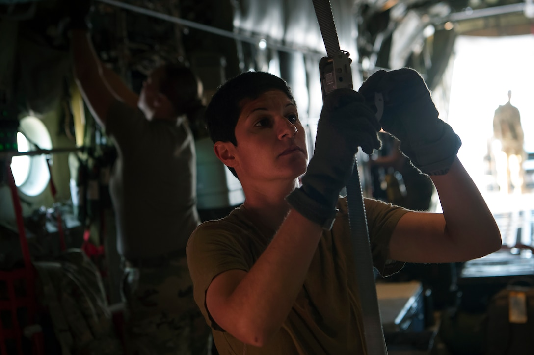 Capt. Sandra Mandell, 379th Expeditionary Aeromedical Evacuation Squadron (EAES) flight nurse, fastens a device used to store medical equipment on a C-130 Hercules at Al Udeid Air Base, Qatar, before a recent aeromedical evacuation mission.